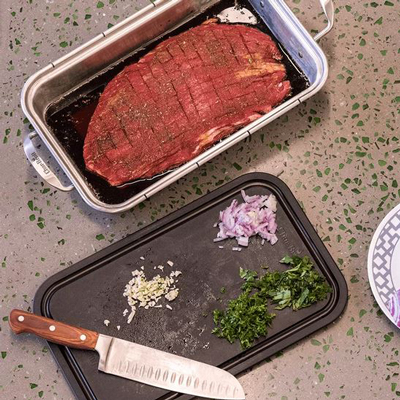 CHAR-BROIL<sup>&reg;</sup> Grill + Deep Dish and Cutting Board - This is a one-trip premium cooking accessory, making it perfect for a wide range of grilling duties. The 9x14 stainless steel deep dish is robust enough to withstand the heat of your grill but also oven safe - making it perfect for roasting, baking or grilling. The plastic cutting board with juice groove doubles as a lid for prep, storage and transport, allowing you to marinate meats and store in the fridge until ready to grill.