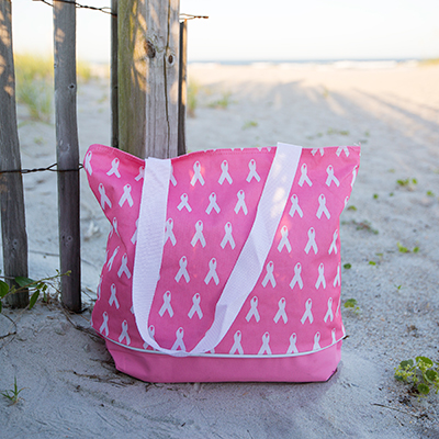 "NAVIGATOR<sup>&reg;</sup> Pink Tote - This handy tote features a zippered top closure and measures 12""H x 17""L and expands up to 10""W at the bottom."